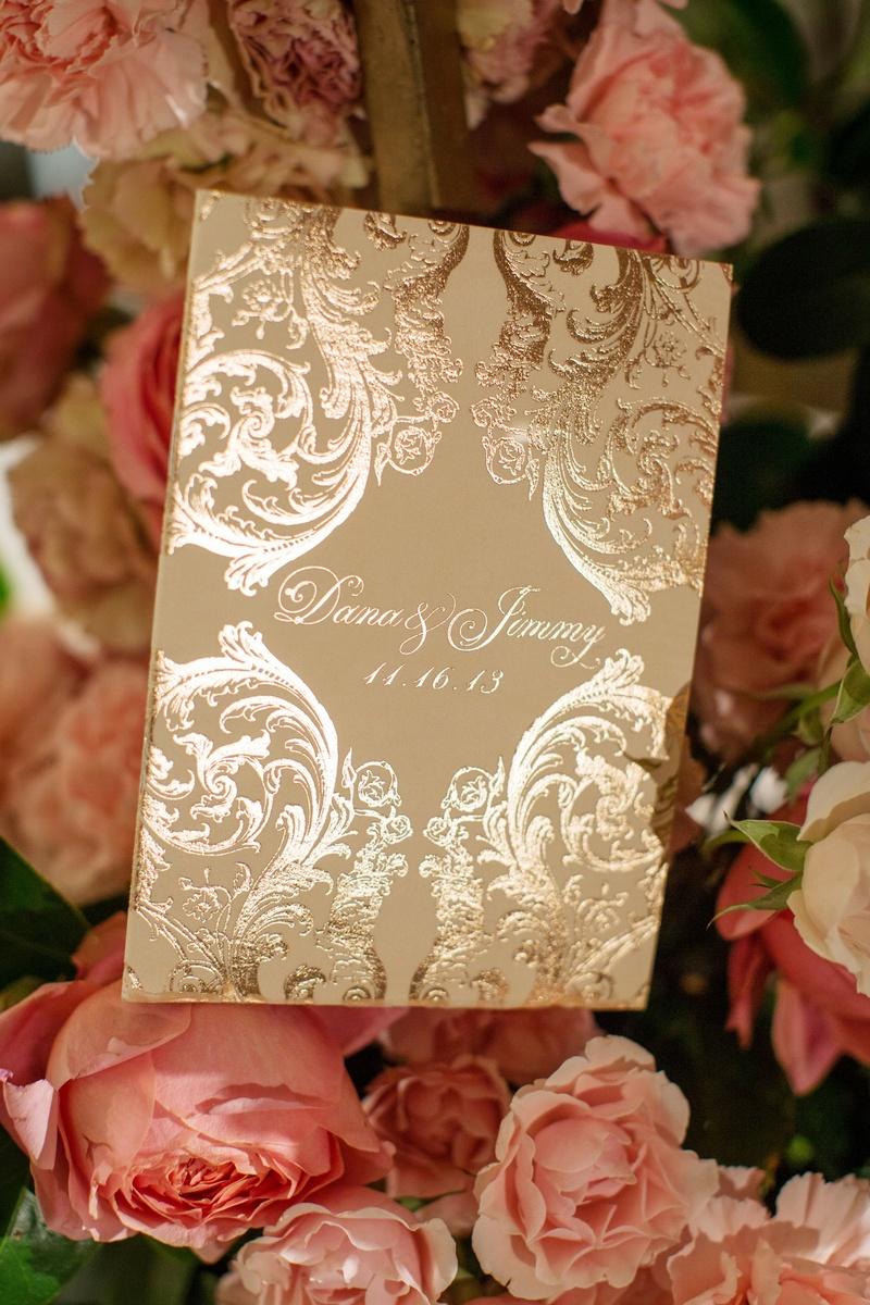 Metallic ceremony booklet and pink peonies