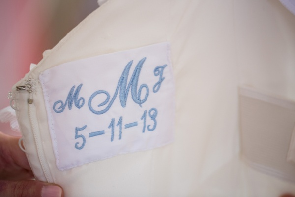 Monogram and wedding date woven into wedding dress