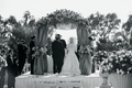 Black and white photo of couple at ceremony altar