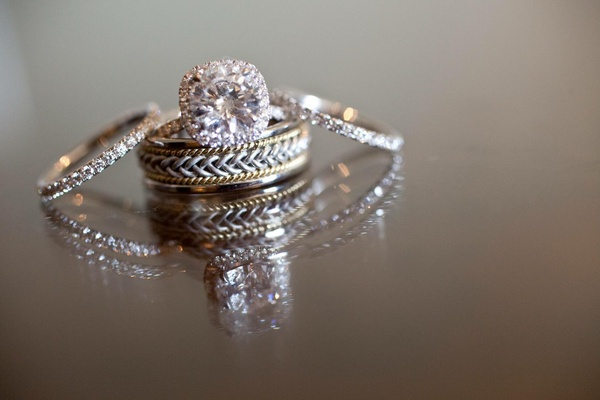 Halo engagement ring with two tone mens band