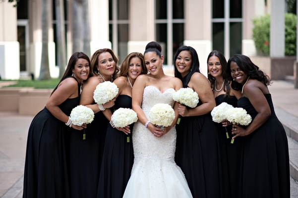 African American bridesmaids holding hydrangea bouquets