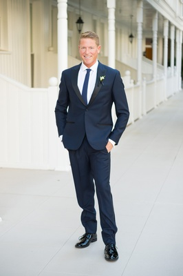groom smiling navy blue suit blonde groom hotel del coronado wedding outdoors summer outfit