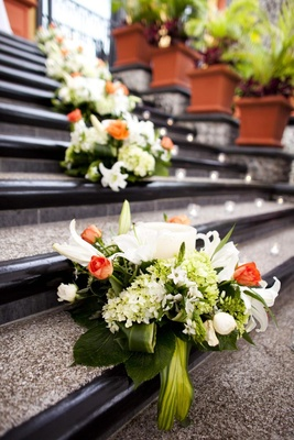Low floral arrangements on hotel stairs