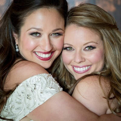 Bride and bridesmaid with pink blush and lipstick