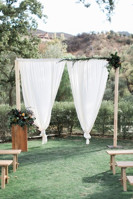 wooden ceremony arch white drapery floral southern california winter wedding styled shoot brookview