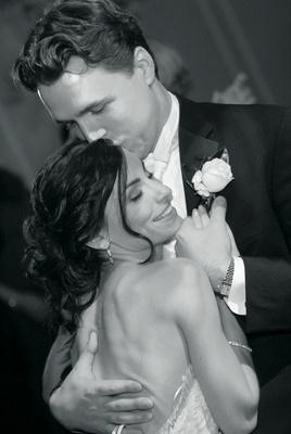Black and white photo of newlyweds embrace
