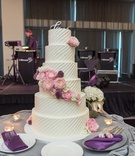 wedding cake with love calligraphy topper diagonal stripe frosting pink peony garden rose flowers