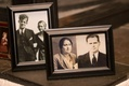 Old family photos in frames at wedding reception