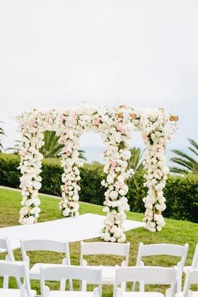bel air bay club wedding, outdoor wedding ceremony on lawn, chuppah covered in flowers