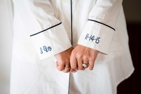 Bride getting ready outfit close up of cuffs on men's shirt pajamas I Do date engagement ring