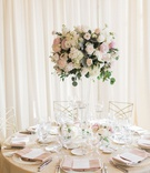 wedding reception drapery tall centerpiece white pink flowers greenery gold chairs pink napkin