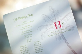 white wedding program with green lettering and palm tree drawing