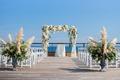 Montauk New York wedding ceremony desk pampas grass greenery white flowers white chairs