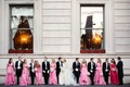 Bride and groom outside hotel with pink bridesmaids