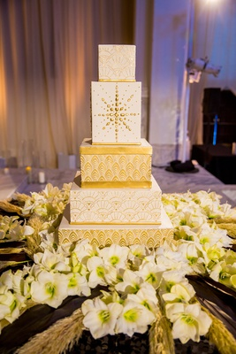 wedding cake with square tiers and gold detailing inspired by 1920s architecture