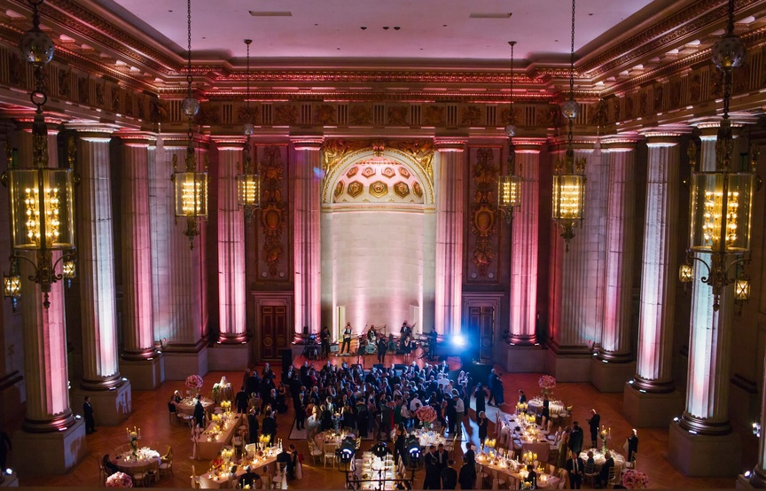 The Source Band for Elan Artists play at a pink wedding reception at Andrew W. Mellon Auditorium