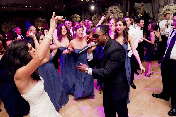 Starlight Orchestras performer on dance floor with bride