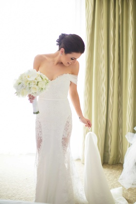 Bride wearing George Elsissa wedding dress lace off shoulder tulle straps lace cutouts on side