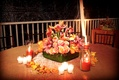 Flower arrangement with red-orange candles