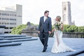 Bride in lace wedding dress with big bouquet colorful groom in grey suit in indiana wedding venue