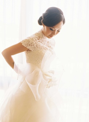 Asian American bride in Vera Wang ball gown with lace short sleeve bodice, natural makeup and updo