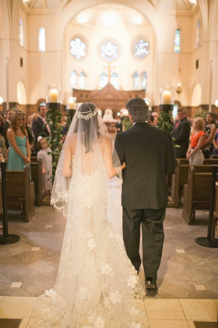 Claire Pettibone veil and dress on bride walking down aisle