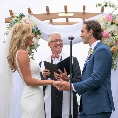 Montreal Canadiens Brian Flynn with wife in Isoude, ceremony arch with white drapery and flowers