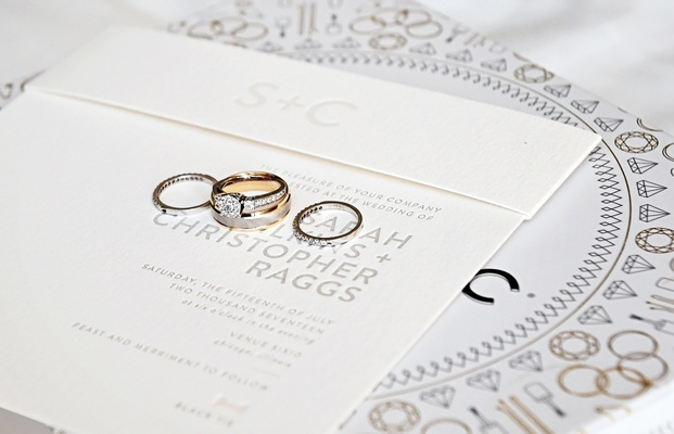 three stone engagemend ring with smaller side stones and channel set band