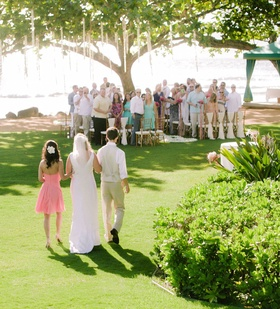 Wedding guests turned to look at bridal processional