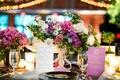 wedding reception paper goods purple menu with gold type and white wine list pink purple centerpiece