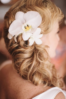 Hawaiian floral hair accessory on side swept ponytail