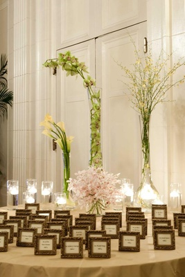 Wedding escort card table with orchid flower arrangements