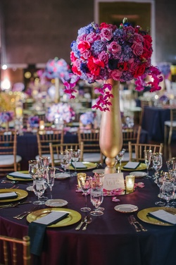 Gold vase with purple and pink rose, orchid, and hydrangea