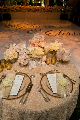 Textured linen sweetheart table with peonies and roses