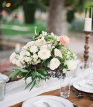 Wood rustic table white linen runner low centerpiece greenery white flowers blush pink ranunculus