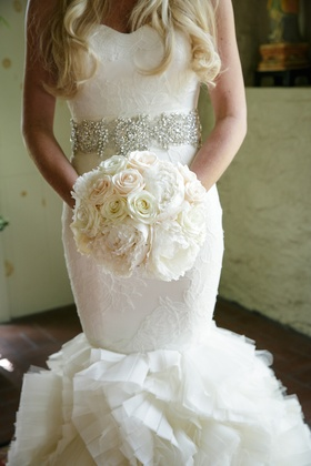 Bride in Vera Wang mermaid wedding dress with peony and rose bouquet