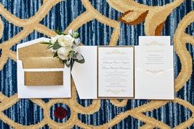 invitation suite with gold glitter border, envelope liner of gold glitter