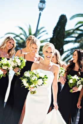 classic wedding bride and bridesmaids black bridesmaid dresses greenery white bouquets