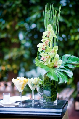 Tropical flower arrangement at wedding bar