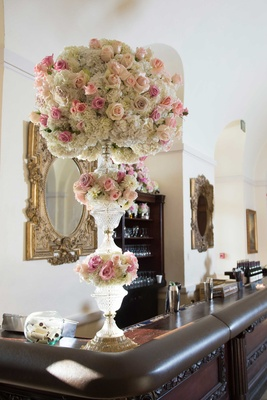 Wedding bar with tall crystal vase flower arrangement white hydrangeas, pink roses