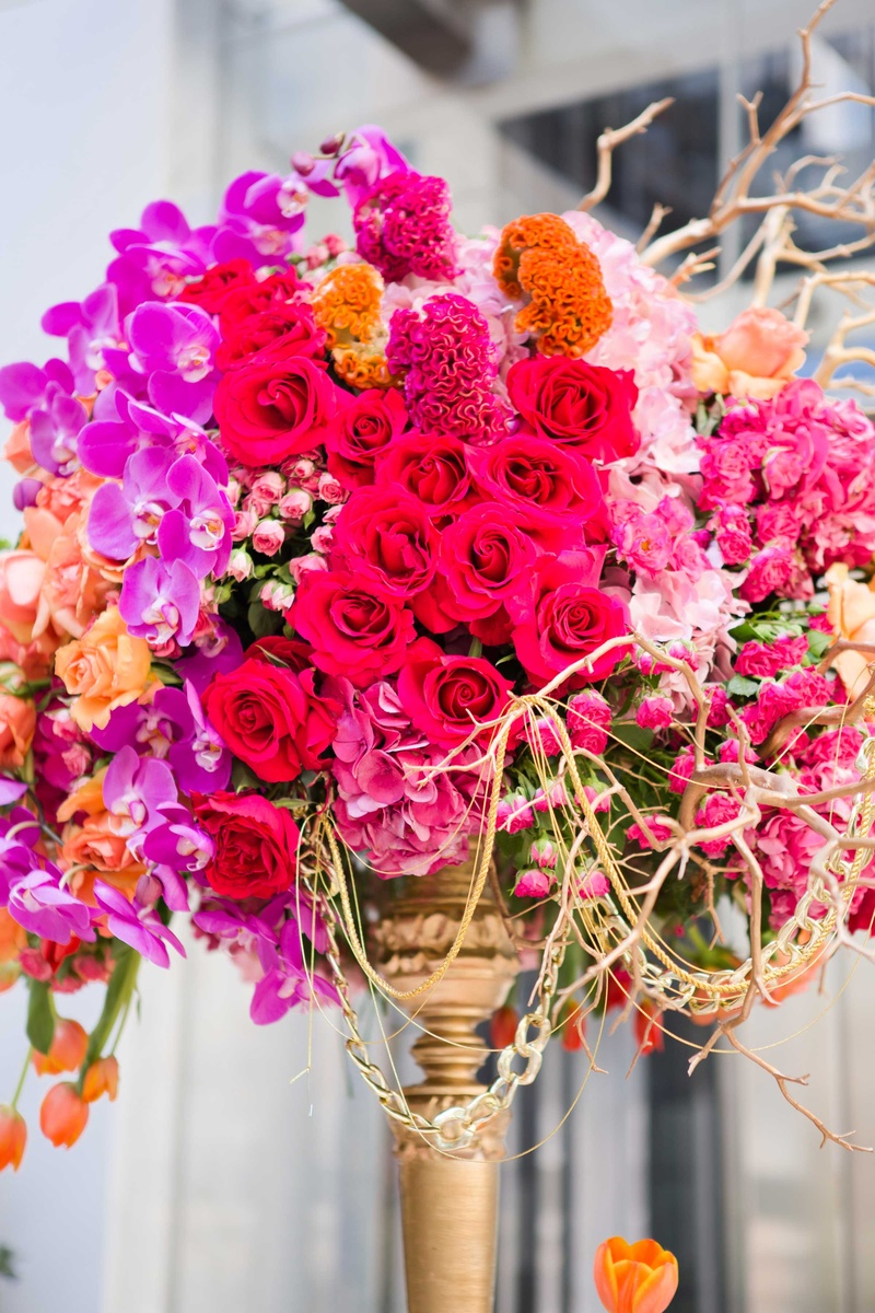 jewel tone blooms tall centerpiece roses orchids tulips branches gold details wedding reception