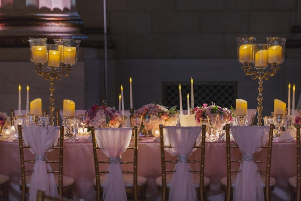 Gold chairs covered with sheer fabric and jewels
