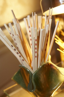 chopsticks with red chinese characters for cocktail hour at wedding