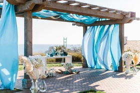 Jewish wedding chuppah with ocean view Terranea blue fabric wood pergola arch
