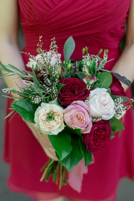 small bouquet with red, blush, ivory roses and greenery