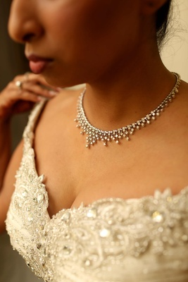 Indian bride wearing gown and diamond necklace