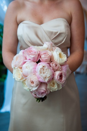 Bridesmaid in ivory dress holding pink and white bouquet