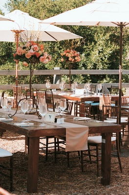 Ojai rustic wedding decorations under umbrellas