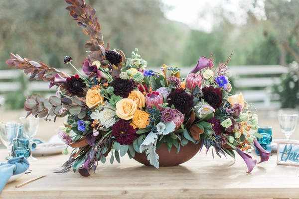 rustic colorful floral centerpiece california winter wedding styled shoot boho rustic pops unique