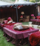 Fuchsia daybeds with pillows for reception guests